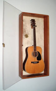 image of a beautiful cabinet and guitar