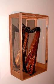 image of a beautiful cabinet holding a harp